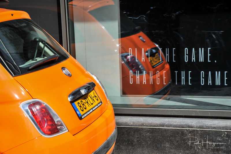 Play the Game, Change the Game Fiat Intersport Orange Reflection Shopping Car Close-up Color Communication Day Ekvrouwenvoetbal2017 Fiat500 Game Land Vehicle Mode Of Transport No People Outdoors Store Text Transportation Utrecht Window