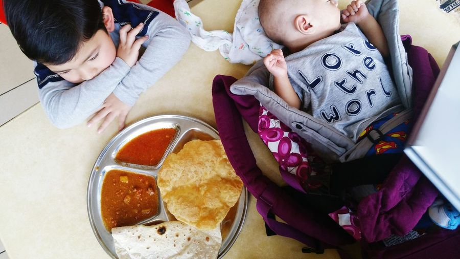 EyeEm Selects High Angle View Directly Above Brothers Newborn Poori Chapati Indianfood Boys Eating Sleeping Baby