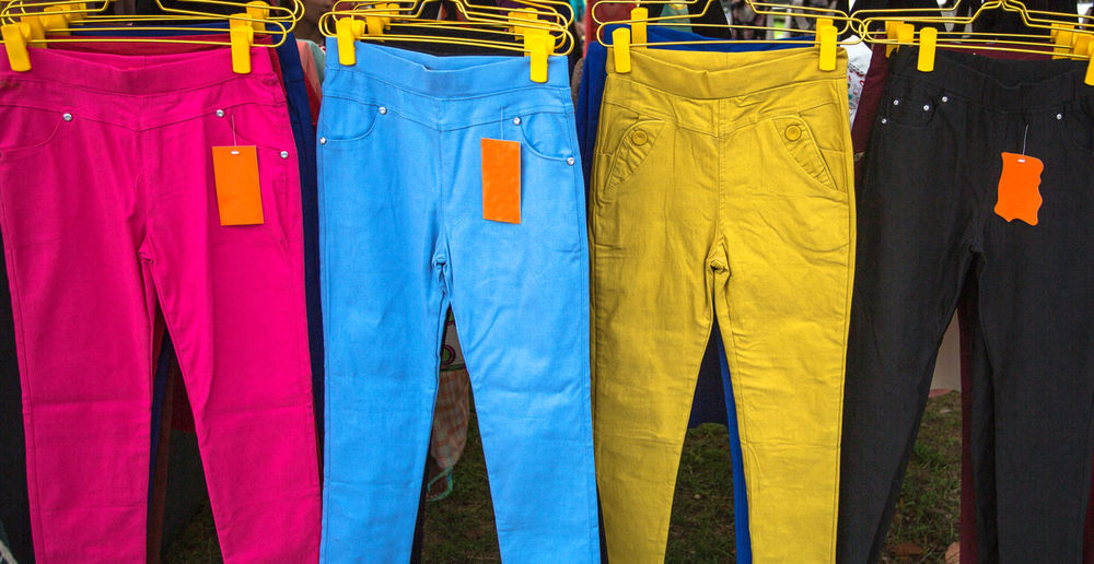 Multi colored pants hanging at store