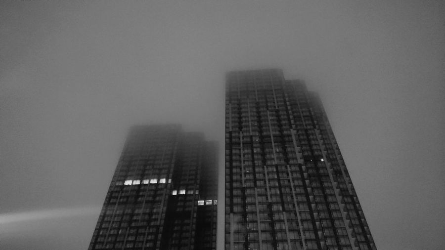 City Skyscraper Modern Urban Skyline Fog Tower Sky Architecture Building Exterior Built Structure Rainy Season