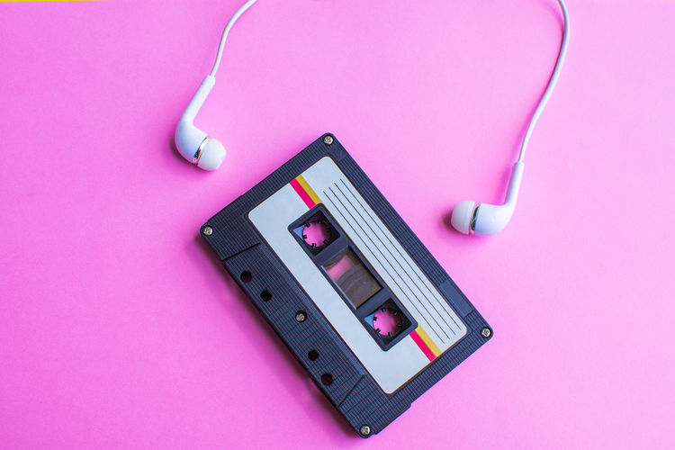Tape Cassette Retro Old Vintage Pink Color Technology High Angle View Still Life Indoors  Pink Background No People Studio Shot Close-up Table Colored Background Equipment Connection Directly Above Work Tool Communication Pencil Headphones Cable Wireless Technology