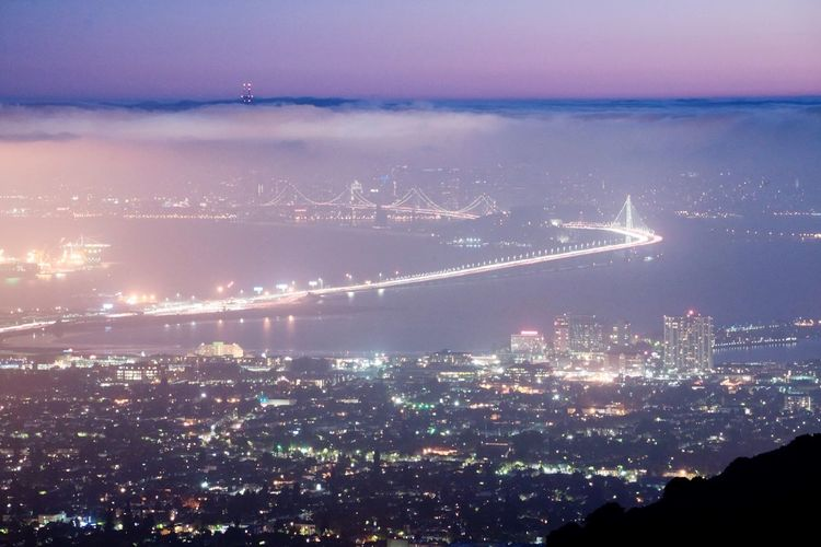 "The ""east bay"" as we call it. The cities east of San Francisco. Bridge Bay Bridge City Lights Cityscapes Fog Foggy San Francisco Night Twinkling Lights Evening Emeryville Oakland Port"
