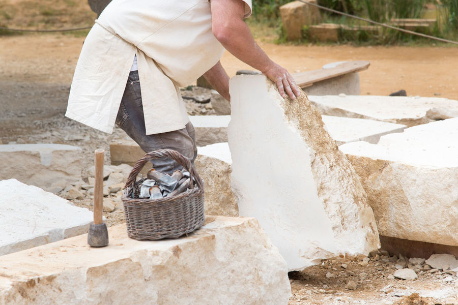 Adult Architecture Chisel Construction Industry Day Hand Holding Human Body Part Human Hand Industry Men Nature Occupation One Person Outdoors Real People Standing Stone Stone Material Stonemason Stonemason Art Stonemasonry Traditional Work Tool Working