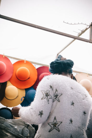 Hat Season Africa Businesswoman Capetown Colour Of Life Colourful Day Hats Headwrap  Low Angle View One Person Outdoors Rear View Rear View Springtime Stars Streetphotography Streetvendor Texture Woman