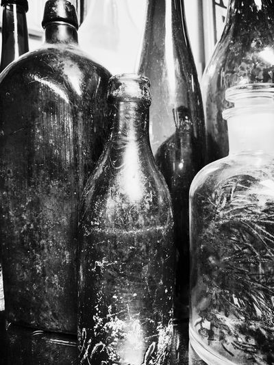 Bottle Refreshment Indoors  Food And Drink No People Shiny Freshness Drink Close-up Day Light And Shadow Glasses Black And White Bobbles &trinkets Monochrome Antique Indoors  Glass Bottle Indoors