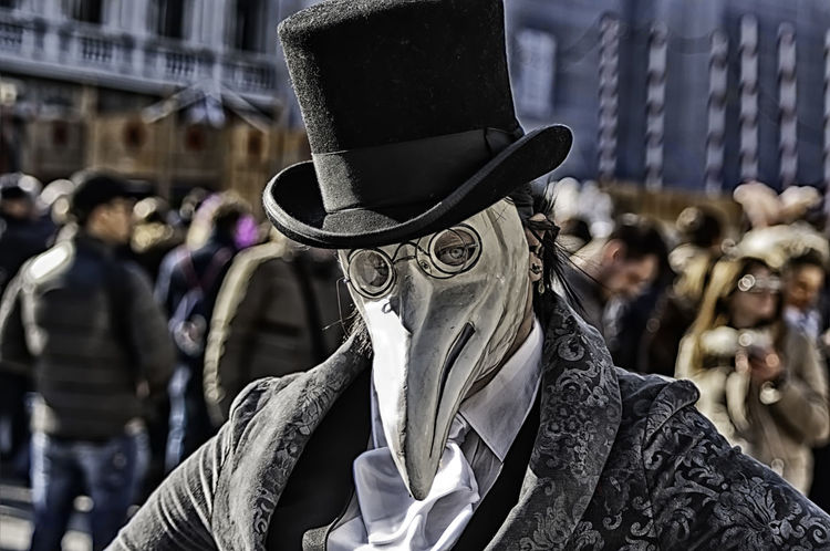 Portrait of a woman wearing mask of a plague doctor during the Venetian carnival party in San Marco square Carnival Disguise Doctor  Masque Plague Tradition Venetian Carneval Close-up Costume Decoration Dressing Festival Hide Italy Mask Masked Masquerade Mistery Mysterious Party San Marco Traditional Unrecognizable Venice