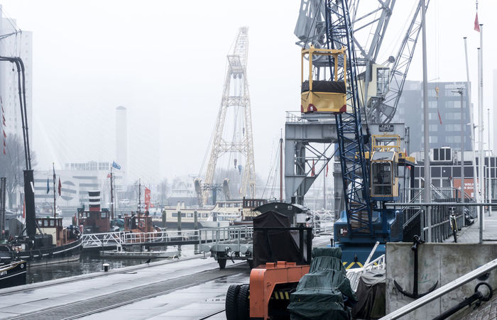Architecture Building Exterior Built Structure City Commercial Dock Construction Site Crane - Construction Machinery Day Fog Freight Transportation Harbor Industry Moored Nautical Vessel No People Outdoors Shipping  Shipyard Sky Technology Transportation