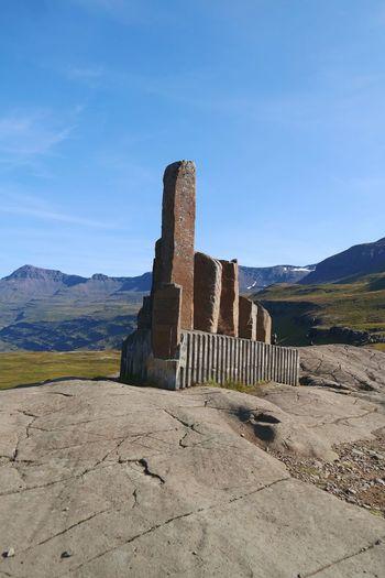 Old ruins on landscape against sky