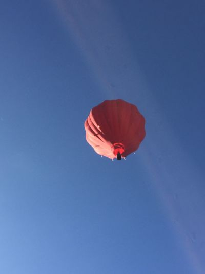 EyeEm Selects Blue Low Angle View Red Flying Outdoors Mid-air Clear Sky Day Parachute Adventure Real People Nature Beauty In Nature Sky Hot Air Balloon