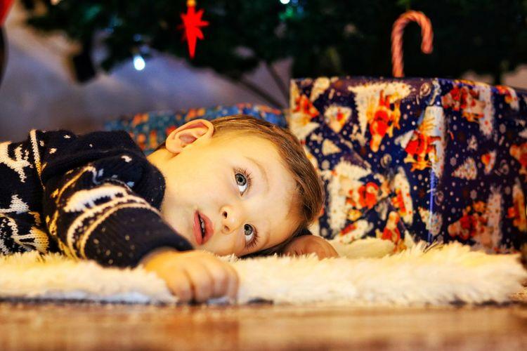 Boy lying on fur rug