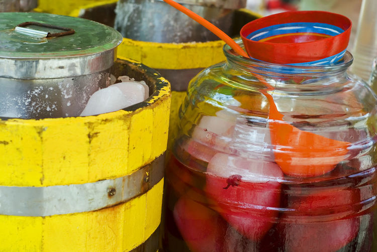 Hamaica tea on the street in Oaxaca, Mexico Mexico Oaxaca Close-up Container Day Drink Focus On Foreground Food And Drink Freshness Hamaica Jar Multi Colored No People Red Retail  Still Life Table Yellow