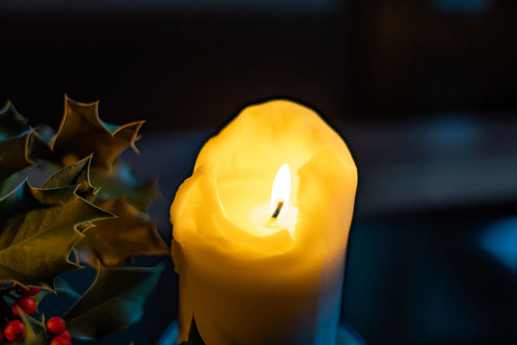 Close-up of yellow burning candle