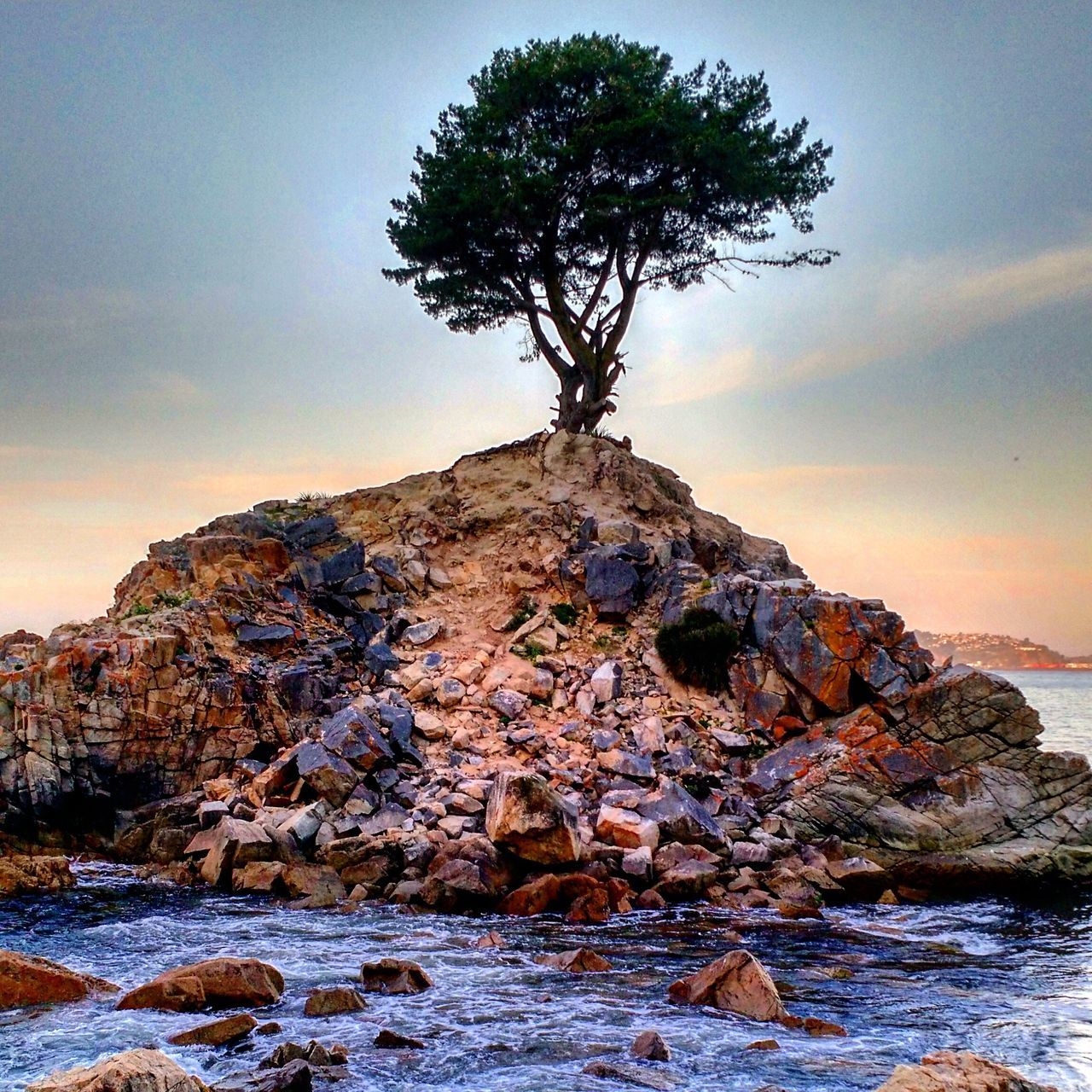 nature, rock - object, beauty in nature, tranquility, rock formation, tranquil scene, scenics, sky, no people, sunset, outdoors, tree, water, landscape, day, sea