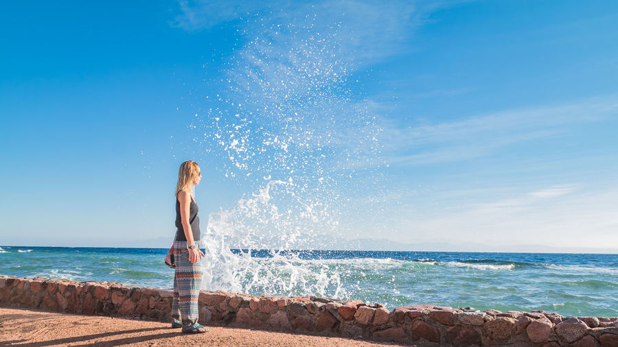 Dahab Red Sea Egypt Sea Waves Splash Woman Pretty Beautiful Water One Person Sky Leisure Activity Beach Land Horizon Over Water Lifestyles Standing Horizon Nature Motion Real People Blue Beauty In Nature Young Adult Side View Outdoors Hairstyle