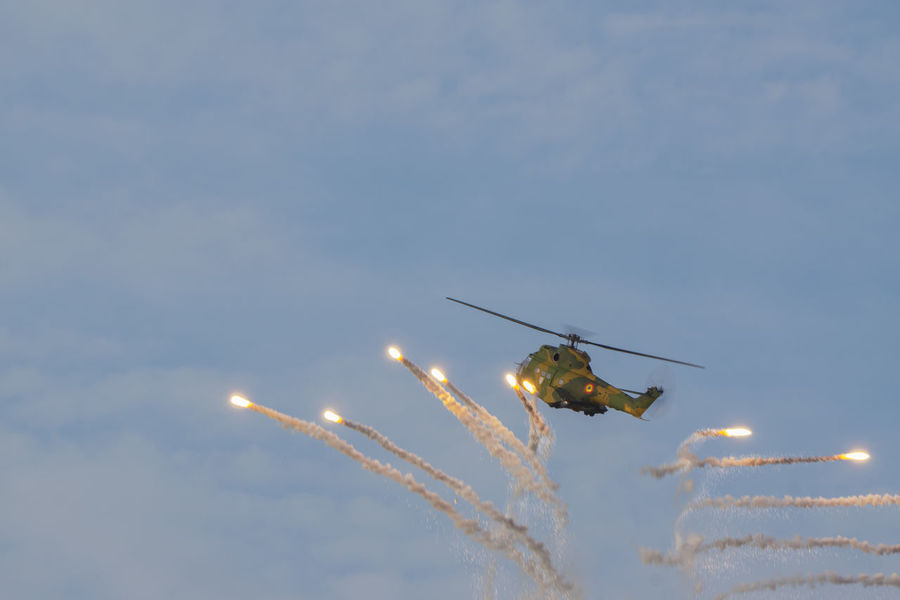 Flying Airshow Air Vehicle Sky Motion Outdoors Aerobatics Air Force Aerial View The Week On EyeEm Clear Sky Air Show Bias2017 Aerobatic Sports Event  Military Airshow Helicopterphotography - Puma Helicopter Helicopter Photography Pyrotechnic Effect Acrobatic Activity Acrobatic Flight Explosions Romanian Air Forces