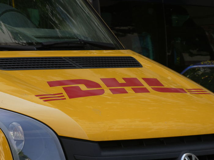 DHL delivery van. Dhl is global market leader in logistics industry. It commits its expertise in international parcel, express, air and ocean freight, road and rail DHL Express Delivery Delivery Service Delivery Van Car Close-up Deliver Delivering Delivery Truck Dhl Land Vehicle Mode Of Transportation Motor Vehicle No People Transportation Yellow