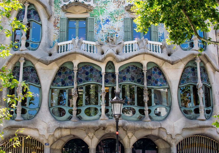 Barcelona Gaudi Gaudí Architecture Arch Arched Architectural Column Architecture Art And Craft Building Building Exterior Built Structure City Day History Low Angle View Nature No People Ornate Outdoors Plant The Past Tourism Travel Destinations Tree Window