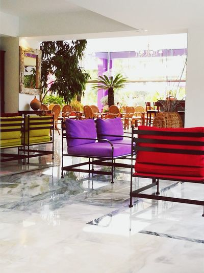Indoors  Furniture Interior Design Lobby Seating Colors Chair Hotel Table Armchair Office Chair