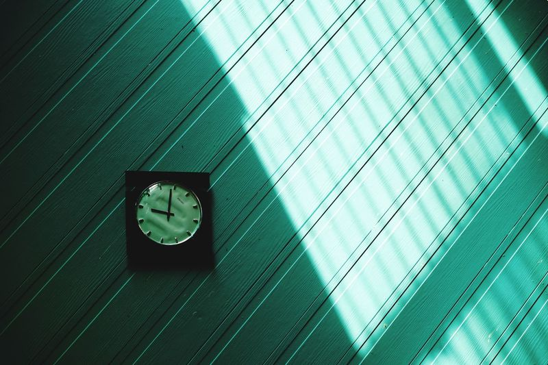 Low angle view of clock on window