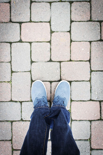 Blue Shoes Blue Blue Shoes Brick Wall Close-up Cobblestone Day Lifestyles Outdoors Personal Perspective Shoe Shootermag Shopping Standing Streetphotography