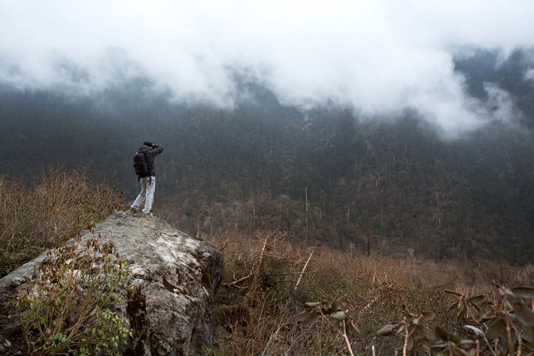 Photographer Adult Adults Only Beauty In Nature Day Fog Full Length Gangtok Hiking India Landscape Men Nature One Man Only One Person Only Men Outdoors People Photographer Photography Plant Sikkim Sky Winter