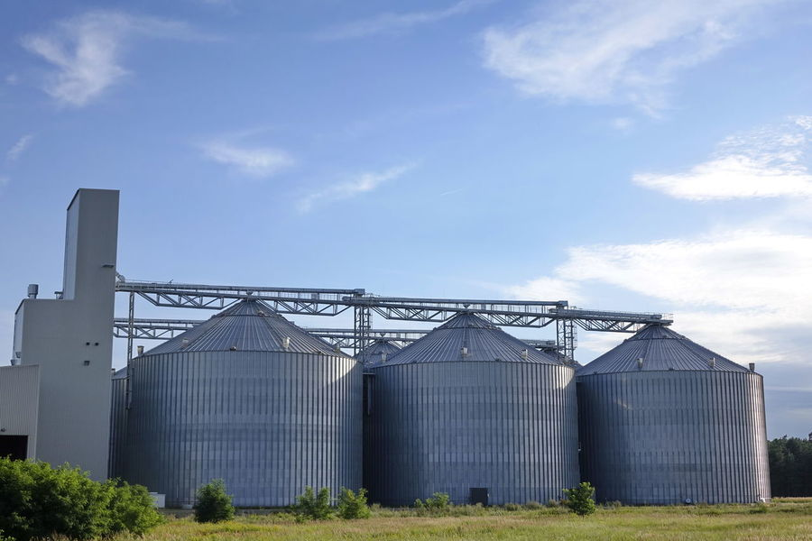 Agriculture Blue Cloud - Sky Day Factory Greenhouse In A Row Industry Nature No People Outdoors Plant Nursery Silo Sky Storage Compartment Storage Tank Warehouse