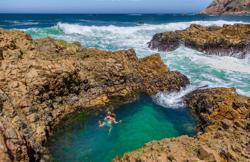 Beach Beauty In Nature Clear Water Day Fun Horizon Over Water Mom And Child In Sea Nature Outdoors Rockpools Scenics Sea Swimming Travel Destinations Turquoise Water Wave Wide Coast