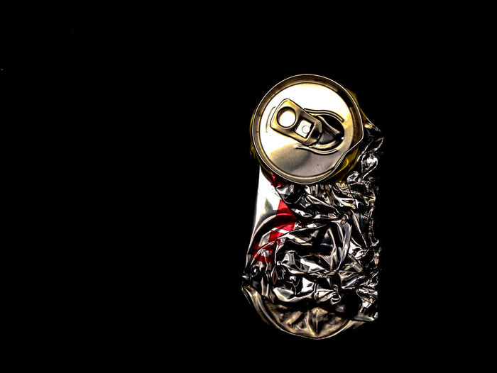 Can Food And Drink Aluminium Can Aluminum Art And Craft Black Background Close-up Copy Space Craft Creativity Cut Out Design Gold Colored High Angle View Indoors  Metal No People Ornate Pattern Representation Single Object Still Life Studio Shot