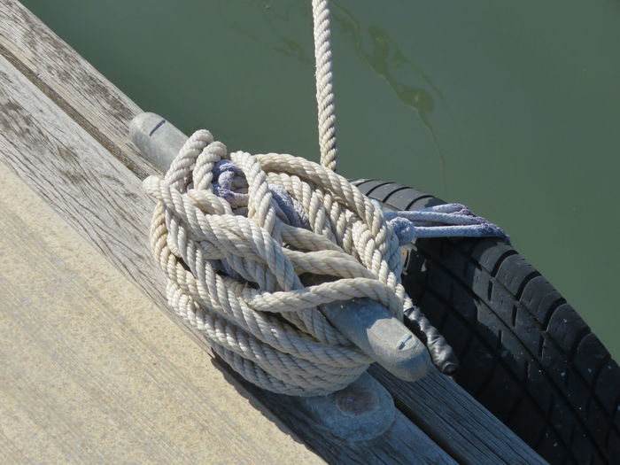 Boat Deck Check This Out Close-up Day EyeEm Best Shots High Angle View Knot Mooring Nautical Vessel No People Outdoors Pier Pulley Rigging River Riverside Rope Sailing Ship Strength Tied Tied Up Tyre Wood Pier Yacht Yachting Finding New Frontiers 17.62°