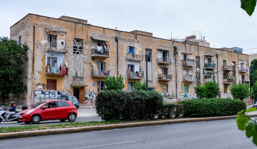 Slums in the middle of Athens, Greece. Old Buildings Slums Athens Greece Athens City Athens, Greece Athens Outdoors No People Sky Building Nature Day Plant Tree Street Architecture Built Structure Road Land Vehicle Building Exterior Motor Vehicle City Car Mode Of Transportation Transportation Motion Travel Luxury