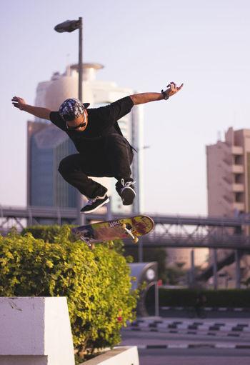 Full Length Of Young Man Skateboarding At Park
