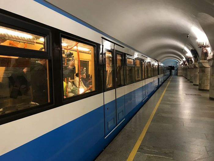 Metro Public Transportation Train - Vehicle Transportation Real People Indoors  Men Illuminated