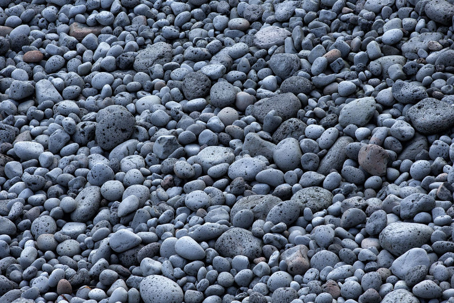 abstract background with round peeble stones Abstract Backgrounds; Basalt Close-up Day Feature; Full Frame Geological; Geology; Gray; Heap; Large Group Of Objects Material; Mineral; Nature No People Outdoors; Pebble Rock; Rough; Smooth; Stack; Stone; Surface; Textured;