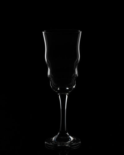 Dark field curves Studio Shot Glass Black Background Indoors  Food And Drink Transparent Drinking Glass No People Still Life Glass - Material Drink Refreshment Household Equipment Copy Space Cut Out Single Object Close-up Alcohol Empty Crockery