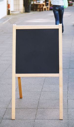 customer stopper Blank Copy Space Blackboard  Board Menu Sign Empty Outside Chalkboard Business Advertisement Advertising Black Bulletin Board City Footpath Incidental People Day Sidewalk Street City Life Outdoors Customer Stopper Standee