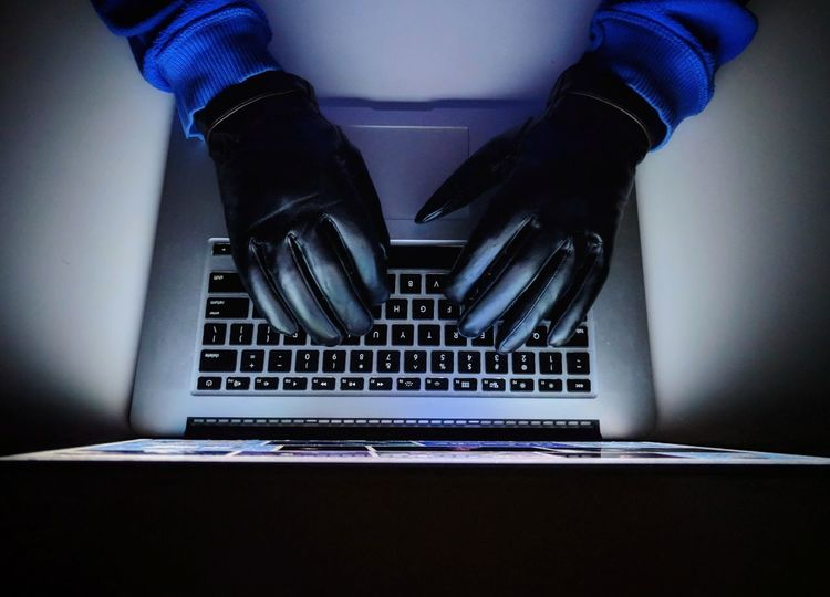 Hacker cracking Andrea coding on laptop. Hacker Keyboard Code Hack Crack Security Cyber Cyber Crime Crime Leathet Leather Gloves Gloves Surf Internet Internet Crime Technology Laptop Computer Wireless Technology Indoors  People One Person