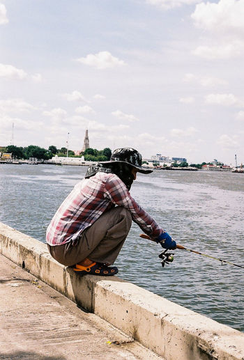 Full length of man fishing in sea