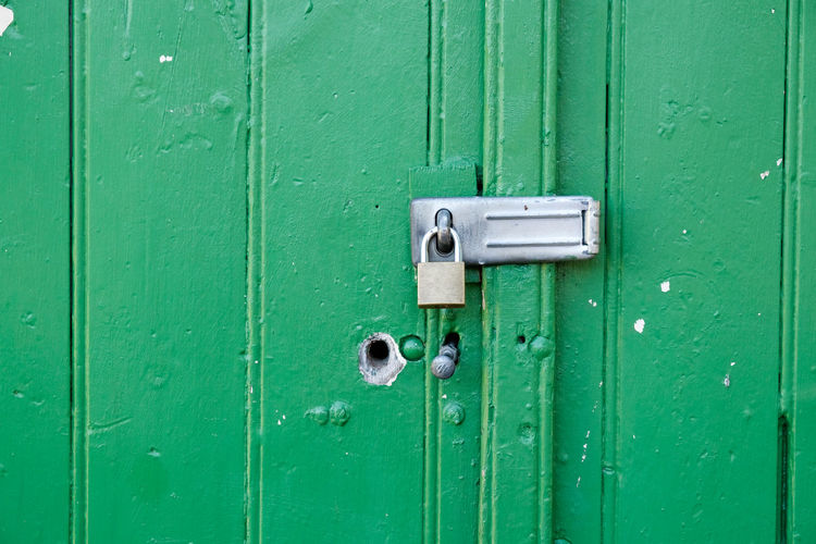 Full frame shot of closed green door