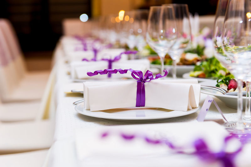 Wedding Table Decorations Appointment Banquet Beauty Celebration Defocused Dinner Formal Glasses Holiday - Event Indoors  Luxurious No People Place Setting Plates On A Table Purple Color Restaurant Romance Table Tablecloth Violet Color Wedding Wedding Ceremony Wedding Reception White Color Wineglass