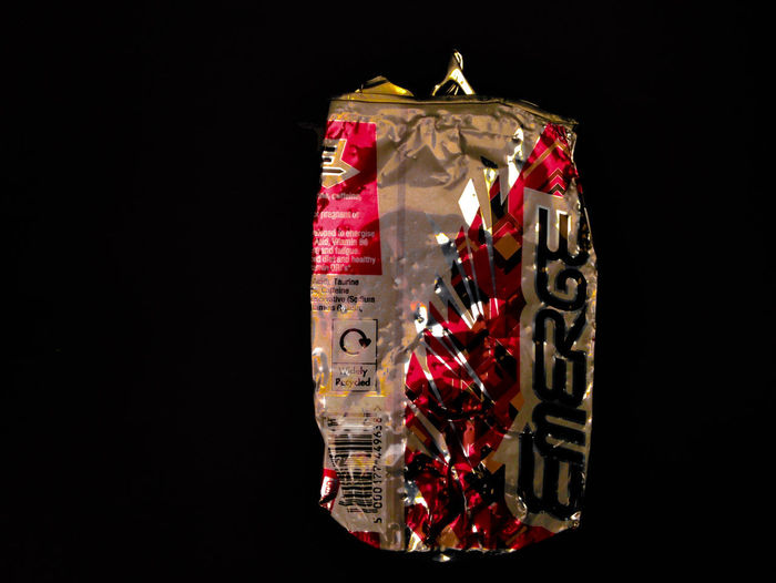 emerge Abundance Black Background Close-up Communication Copy Space Cut Out Finance Food And Drink Indoors  Large Group Of Objects Message Multi Colored No People Packet Red Single Object Still Life Studio Shot Text Wealth Wrapped