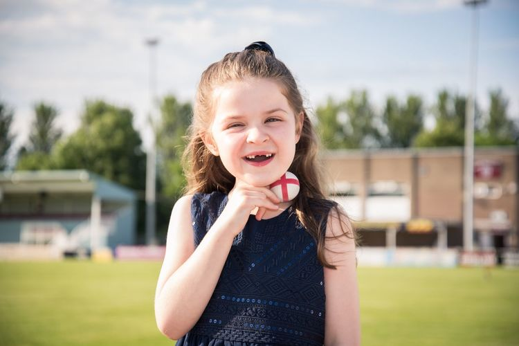 Portrait of smiling girl on football field
