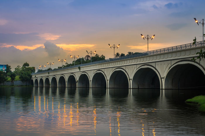 Enjoy the sunset at the fishing location Architecture Bridge Sunsets Sunset_collection Beutiful Nature Bridge Bridge Shadows Clouds And Sky Landscape Sunset Sky Clouds Skylovers Travel Traveling Photo Picture Photography No People Reflections In The Water Streetlights Water