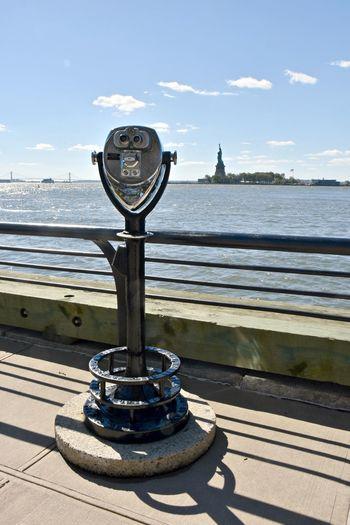 Ellis Island  Ellis Island / Statue Of Liberty Statue Of Liberty Binoculars Coin Operated Coin-operated Binoculars Day Lady Liberty Outdoors Railing Statue Cruises Sunlight Travel Destination Travel Destinations Travel Destinations Outdoors
