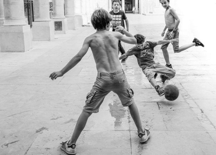 Palais De Tokyo Street Real People Children Blackandwhite Fujifilm Streetphotography City Life Street Football