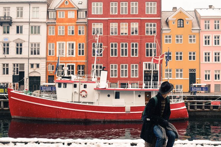 A Man In A Hat Architecture Building Exterior Denmark Hat Kopenhagen Newhaven Red Ship