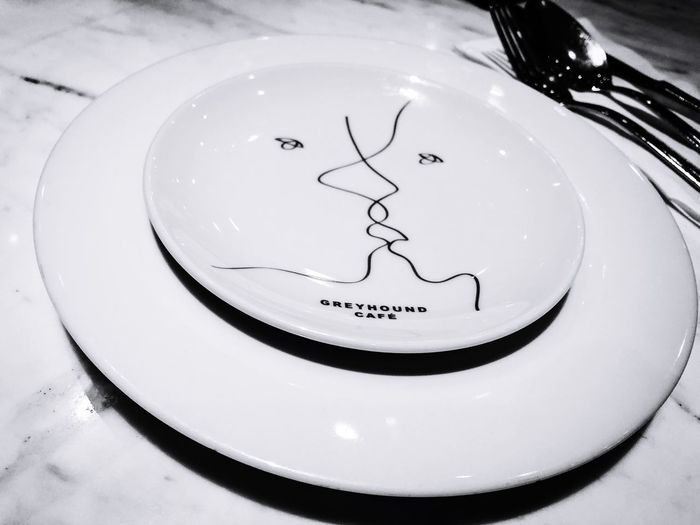 Plate Text No People High Angle View Indoors  Close-up Western Script Geometric Shape Food Shape Circle Sweet Food Representation Drawing - Art Product Communication White Color Table Food And Drink Creativity Still Life