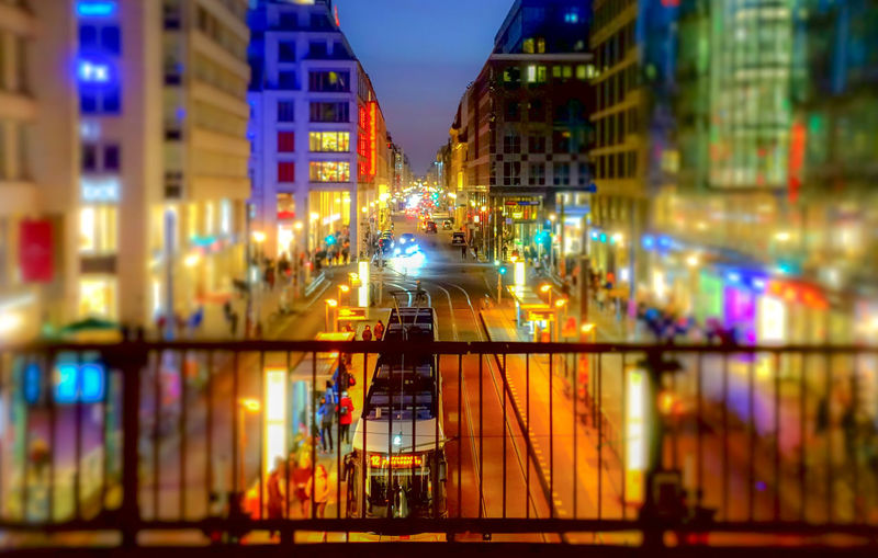 Tilt-shift Tiltshift Night Nightlife Shopping Famous Place Multi Colored Colorful Friedrichstrasse Tram Public Public Transport Blue Hour Neon Lights City Cityscape cityscapes Business Business Finance And Industry Illuminated Building Exterior Architecture Built Structure Motion Blurred Motion Transportation Long Exposure Building Glowing Reflection Mode Of Transportation Street Dusk Outdoors Speed