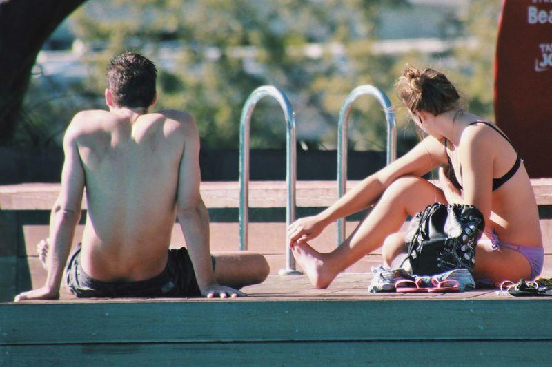 People Sitting At Poolside