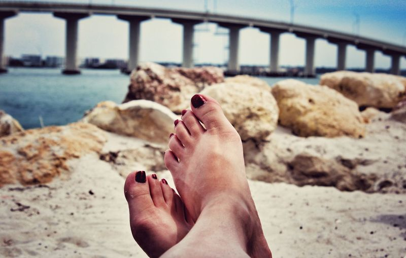 Low section of woman legs on beach