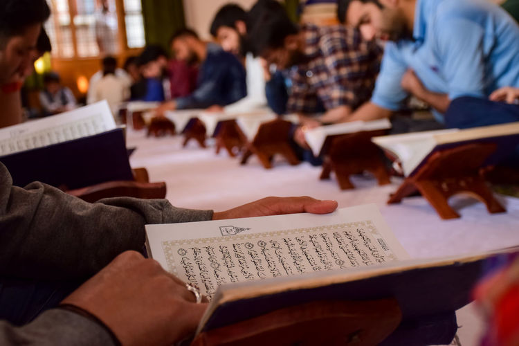 Young men reading koran in mosque